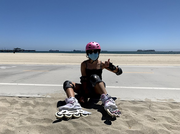 picture of a girl in rollerblades on a street beside a send