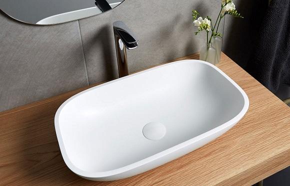 white bathroom sink on wood