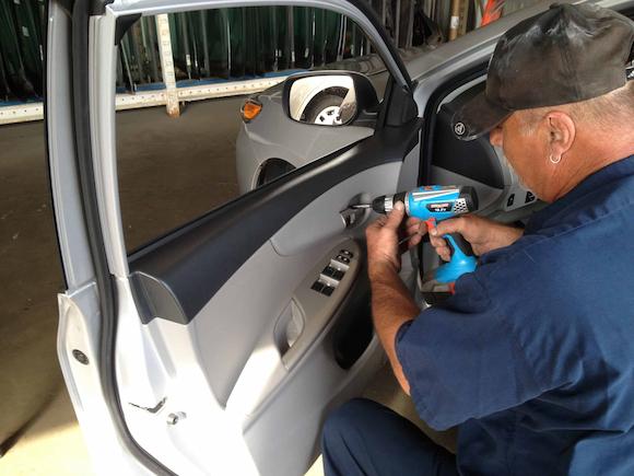 guy repairing car windows