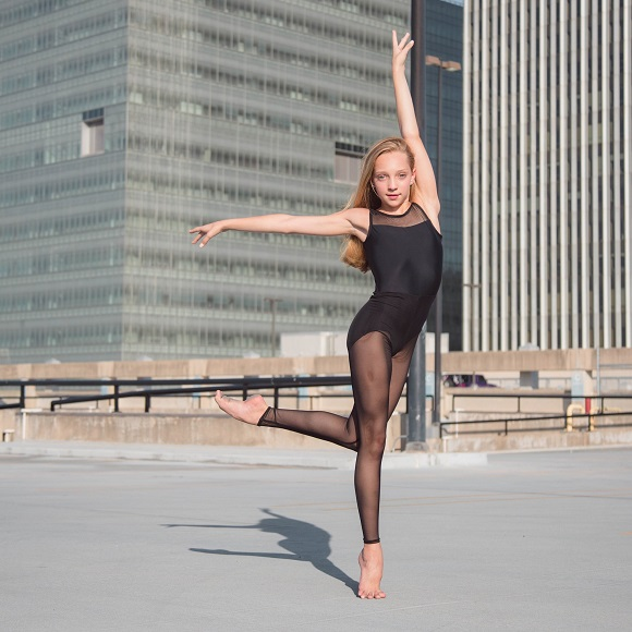 picture of a girl dancing on a roof of a building